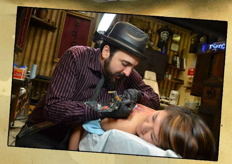 jose menendez tattoing a client